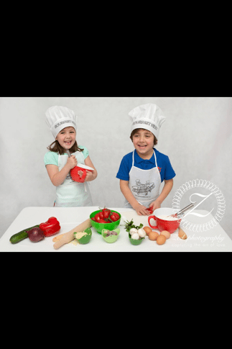 two kids with vegetables